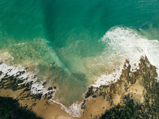 Aerial Shot Of Waves Moving Towards Shore At Beach