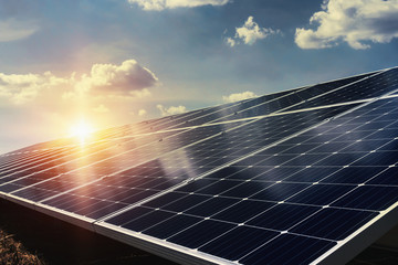 solar panel with sunlight and blue sky background. concept clean energy power in nature