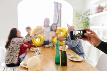 Family gathering celebrating grandma birthday.