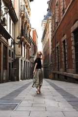 Trendy woman on street of old city