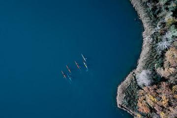 People kayaking on lake.