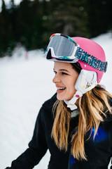 Girl smiling and enjoying on ski vacation