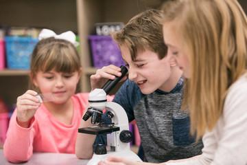 Classroom: Boy Looks Through Microscope