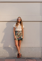 Trendy young woman on pavement