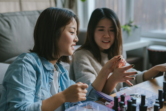Girls doing their nails at home