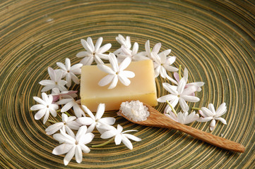 Foto op Plexiglas Spa Spa Bath composition with lwhite flower, soap, salt in spoon on wooden bowl