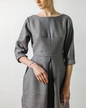 Crop woman in gray dress