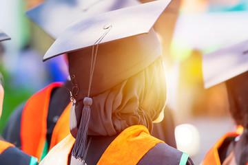 Congratulution concept,Muslim women,Graduates at university graduation ceremony wearing mortarboard.