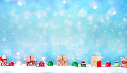 Collection of Christmas gift boxes in a snow covered landscape