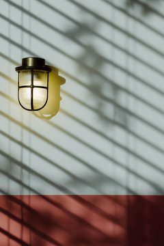 Brass Lamp on Pink Wall