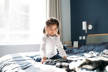 Asian family folding laundry at home