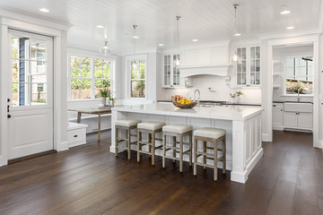 White Kitchen Detail in New Luxury Home with Lights On