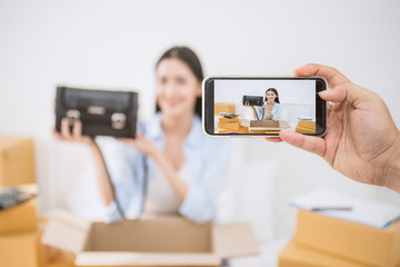 SME freelance woman talking to camera live record video social network, Young Asian small business owner using smartphone, online marketing delivery, SME e-commerce telemarket concept