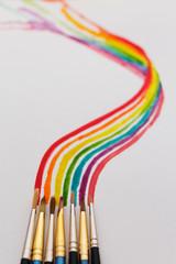 Watercolored rainbow swirl and brushes