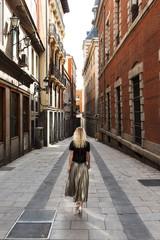 Anonymous woman walking on street