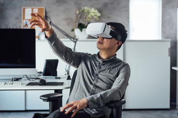 Businessman wearing VR in office