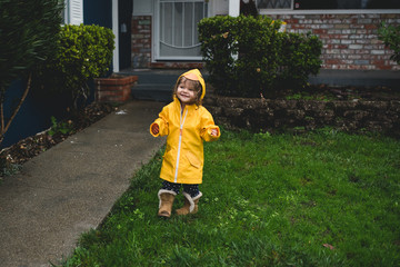 Happy Toddler in the rain