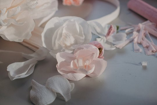 Messy table of an artist creating paper flowers