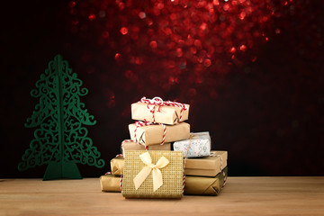 image of handmade wrapped gift boxes over wooden table.