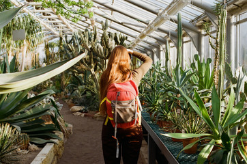 Girl taking photo in the greenhouse