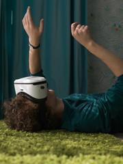 Relaxing man experiencing cyberspace in VR glasses