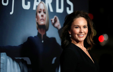 """Cast member Lane poses at a premiere for the television series """"House of Cards"""" in Los Angeles"""