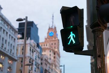 Glowing crosswalk semaphore on street