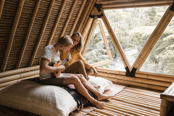 Romantic couple in the jungle cabin