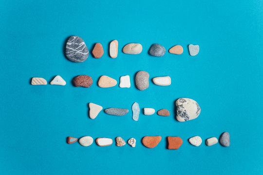 Rocks organized on a blue background