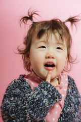 Cute little kid making thinking face