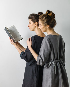 Two women reading book