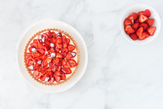 Strawberry Cake and Strawberries in a Bowl on White Marble