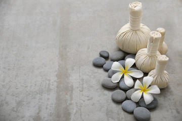 white frangipani with stones and , herbal ball.on gray background