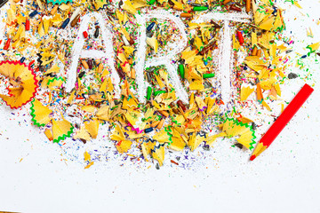 ART word on the background of colored pencil shavings