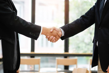 Business acquisition concept, Cropped shot businessman shaking hands finishing up a meeting.