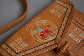 Moscow, Russia - 10 23 2018: Egyptian souvenir leather bag with pattern