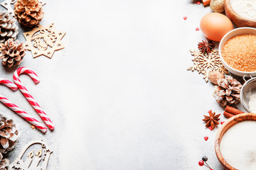 Christmas or New Year composition with ingredients for baking or cookies, with golden snowflakes, Christmas balls, on gray background, with inscription merry xmas, frame, top view
