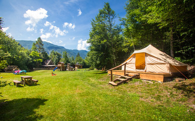 Tuinposter Kamperen Family tent in Adrenaline Check eco resort in Slovenia.