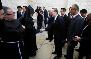 Chinese Vice President Wang Qishan is greeted during a visit to the Church of the Nativity, in Bethlehem in the occupied West Bank