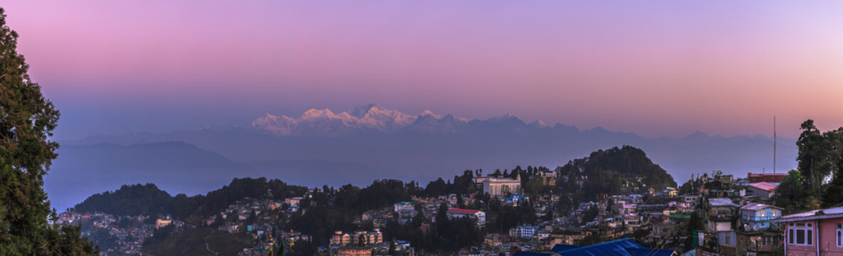 View of a mountain ridge of Kanchendzhonga in the State of Sikkim, from the neighborhood of the city of Darjeeling, early in the morning, till the sunrise.