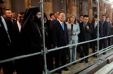 Chinese Vice President Wang Qishan looks on as Palestinian Minister of Tourism and Antiquities Rula Ma'ayah stands next to him during his visit to the Church of the Nativity, in Bethlehem in the occupied West Bank