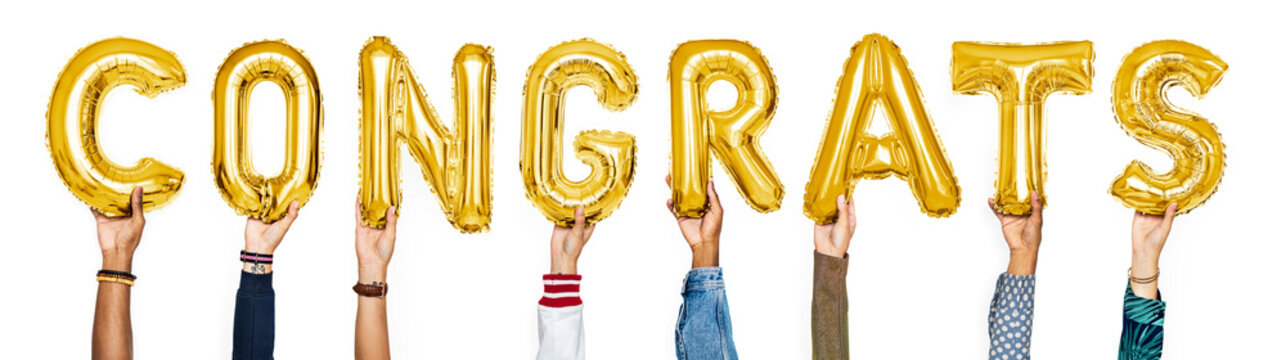 Yellow gold alphabet balloons forming the word congrats