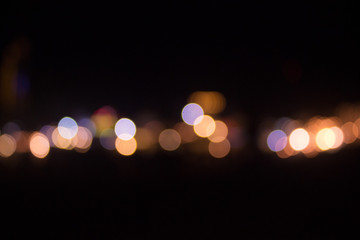 Colorful bokeh of the city in the midnight with blurred background