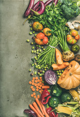 Wall Mural - Healthy vegetarian seasonal Fall food cooking background. Flat-lay of Autumn vegetables and herb from local market over grey concrete background, top view, copy space. Clean eating, alkaline diet food