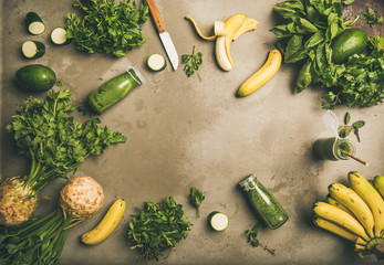 Making green detox smoothie. Flat-lay of ingredients for making green smoothie over concrete background, top view. Weight loss, healthy food concept