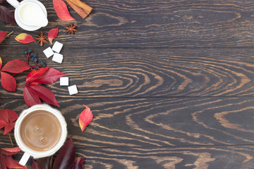 Cup of coffee, spices, sugar cubes, autumn leaves. Autumn decor, fall mood, relaxing and still life concept. Flat lay, top view. Copy space.