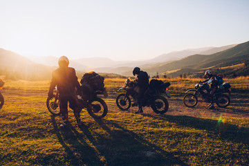 Stunning image of the group of bikers in the evening light. Concept active extreme rest.