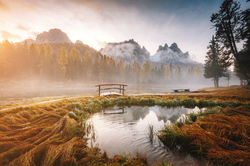 Stunning image of the foggy lake Antorno in National Park Tre Cime di Lavaredo.