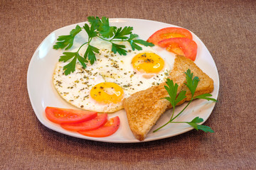 breakfast on plate, fried eggs with vegetables