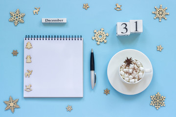 calendar December 31 cup cocoa and marshmallow, empty open notepad
